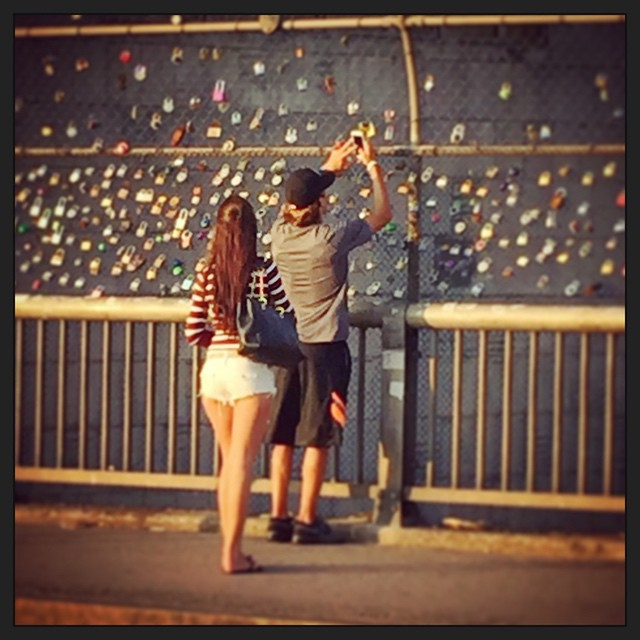 A secret #Boston tradition. Young #lovers will put a padlock on the fence above the #MassPike to show their commitment and #love to one another. It's #MassAve's answer to a commitment ring. And we caught these two sweeties during a ride.  #OnlyOnAPedicab #OnlyOnPedicab #150RidesOfSummer #BackBay #Berklee #BostonPedicab #younglove #truelove #PedicabNation