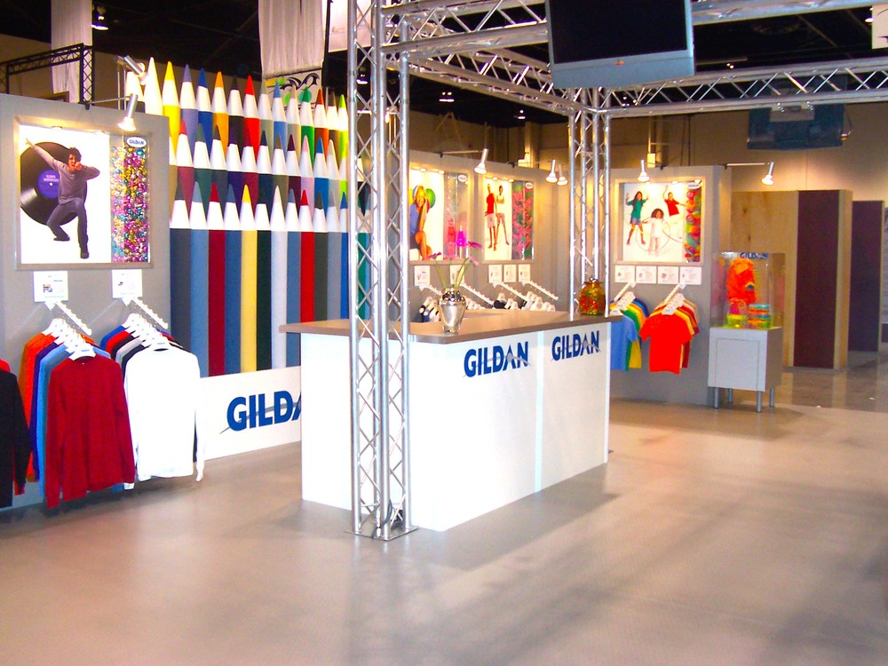 Montreal-based Gildan Activeware is North America's second most productive apparel company, with profit margins of 14.66%. Tradeshow booth photo: www.visualmerchandisinggroup.ca