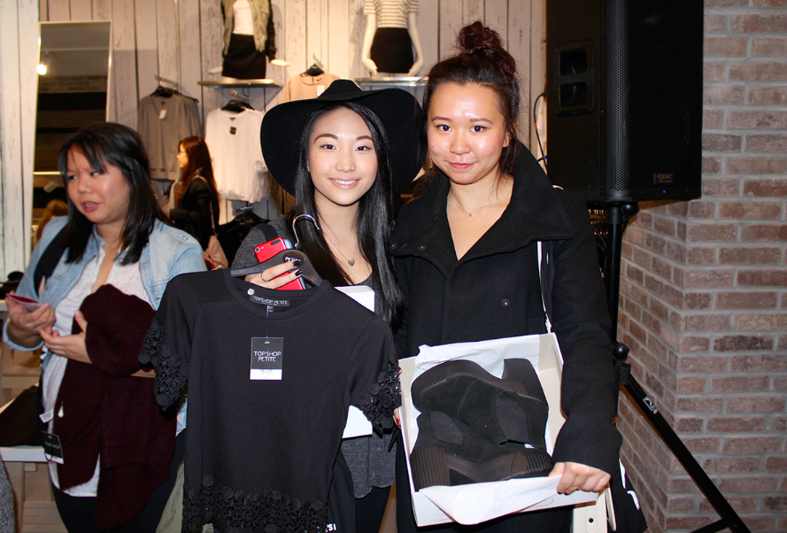 Samantha Luk and Sally Poon show off their purchases at the TOPSHOP store opening - black lace panel tee, floppy wool fedora hat and black HOLA Suede Chelsea Boots.