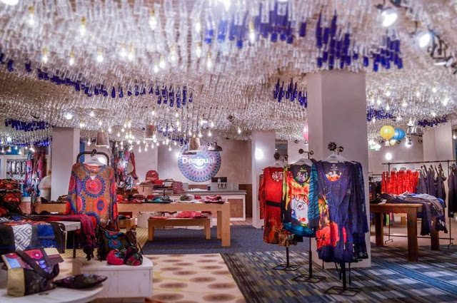 7,000 glass bottles hang from the ceiling of Montreal's Desigual store. Photo: http://journalmetrocom.files.wordpress.com