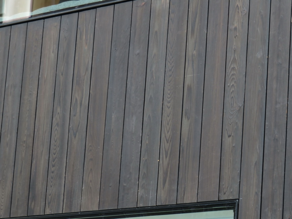 Wood paneling on the store's exterior. Photo by Greg