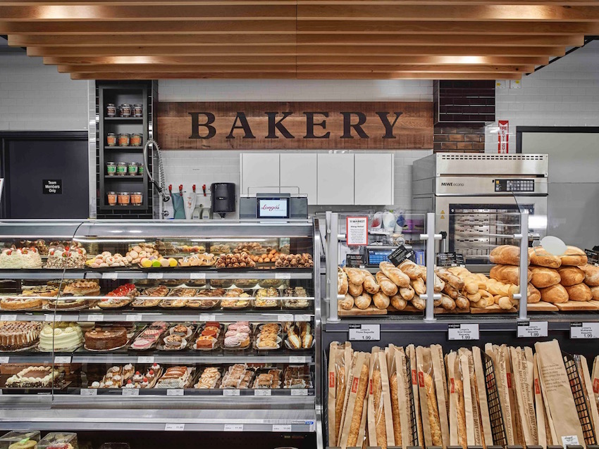 Bakery - Reclaimed wood used as the Bakery signage provides depth and texture as well as the suspended trellis above creates a more intimate service point.