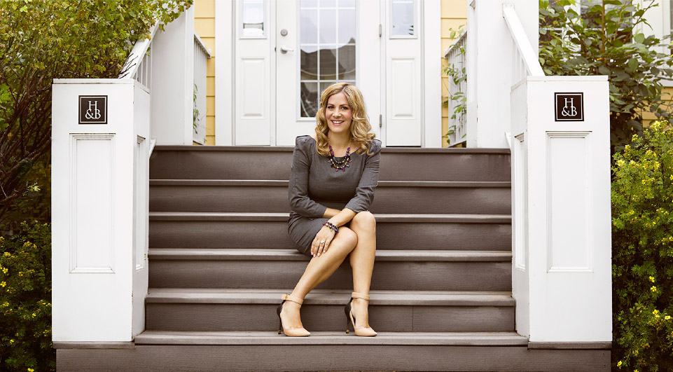 Rachel Mielke on the steps of the Regina flagship. Photo: Hillberg & Berk