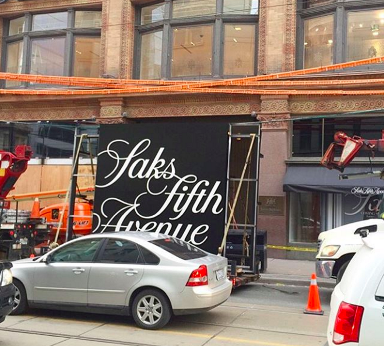 Saks signage being installed on the Queen Street store on Feb 6, 2016. Photo: Saks, via Instagram