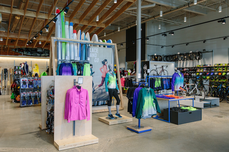 Displays at the entrance to the store feature athletic wear as well as a wood 'canoe rack' in Canadian maple plywood.