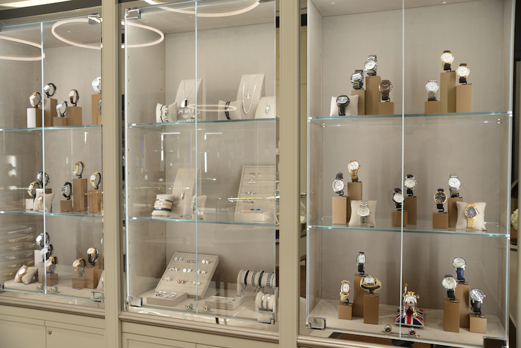 Display cases with men's and women's watches as well as cufflinks and other jewellery pieces. Photo: Tom Sandler