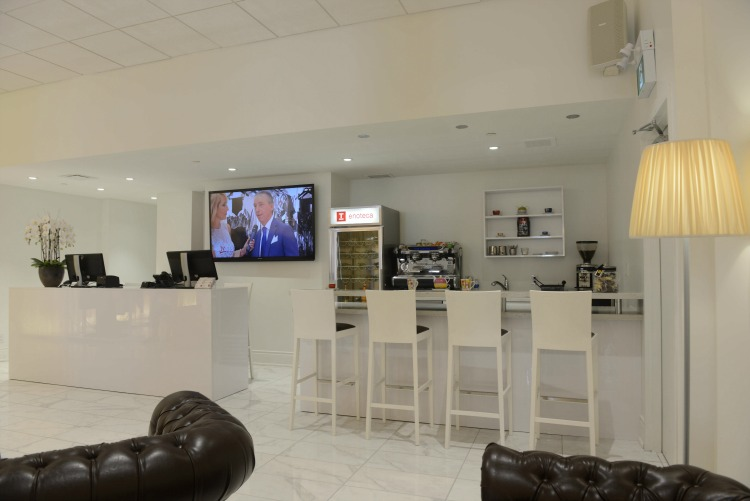 Ground floor bar area and cash desks, as well as a video screen playing Italian fashion television. Photo: Tom Sandler