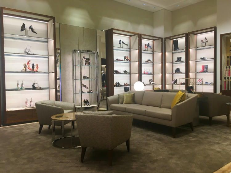 Women's footwear salon features plush carpeting and comfortable, residential-like seating. Photo: Chantal Mizerski, Retail Council of Canada.