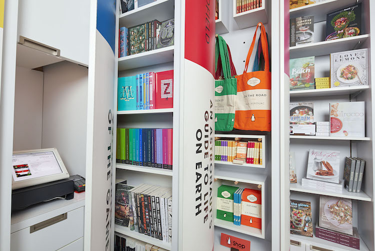 POS system at the left can be concealed behind a 'book spine', with other shelving pulled out to demonstrate functionality in this photo.
