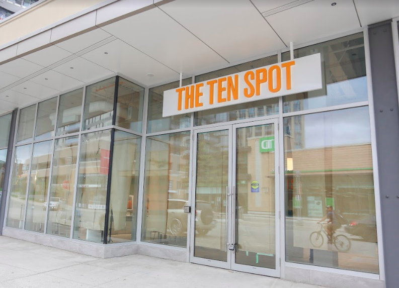 Paper over the windows at the soon-to-open CF Shops at Don Mills location. Photo: The Ten Spot.