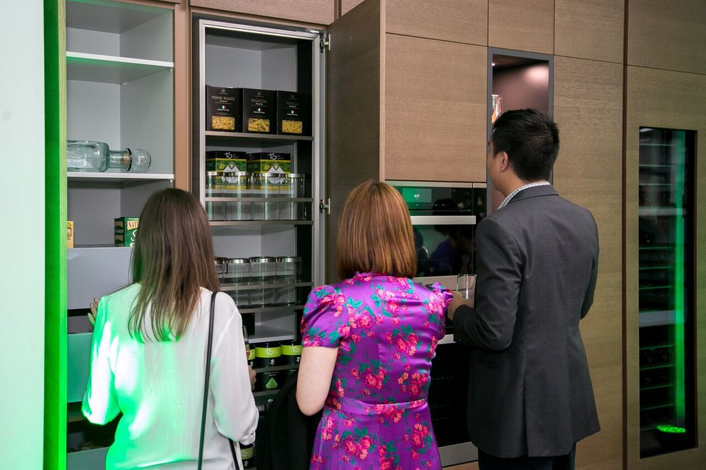 Viewing displays at the store's opening event.