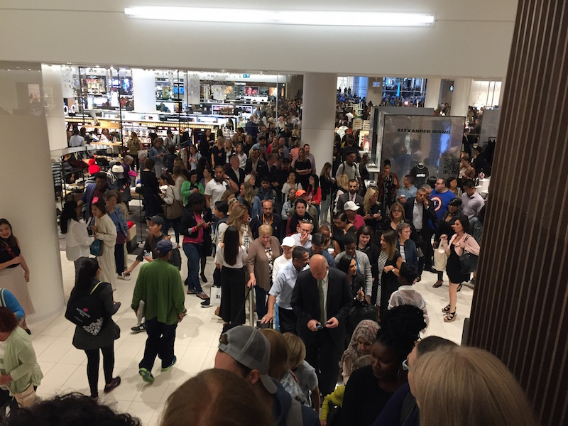 On the escalators looking towards crowds moving into the store.   Photo: Devon Johnson