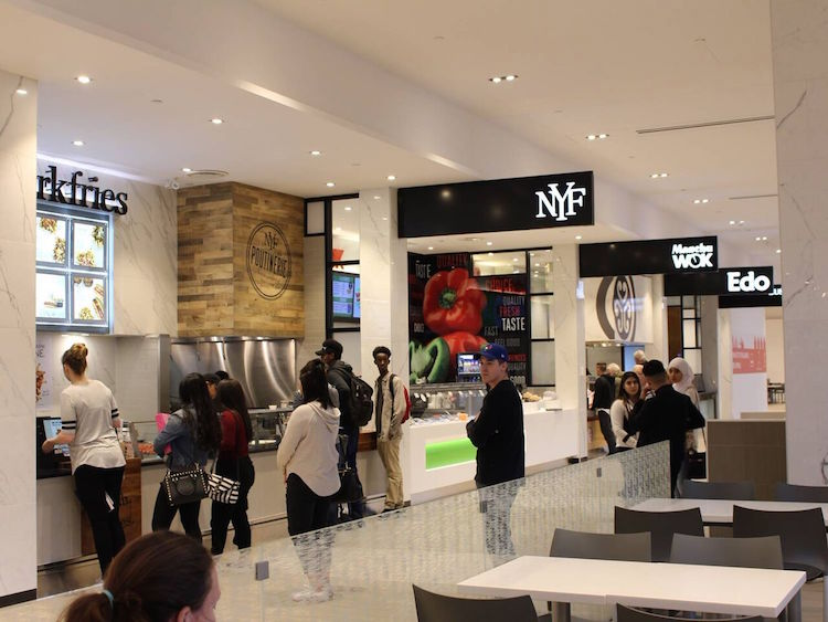 After: A modern food court with unified tenant branding. Photo: 20 Vic Management Inc.