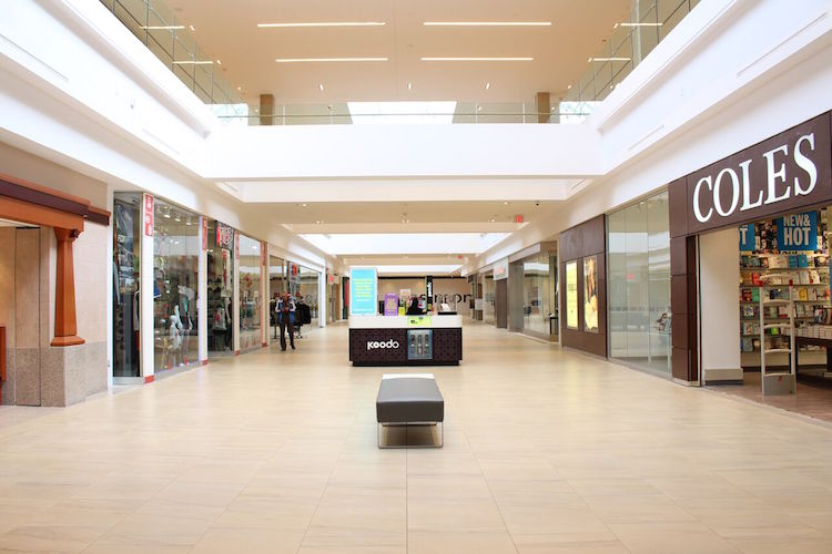 After: New bright, modern retail corridor at Londonderry shopping centre. Flooring is a durable porcelain that looks like sandstone. Photo: 20 Vic Management Inc.