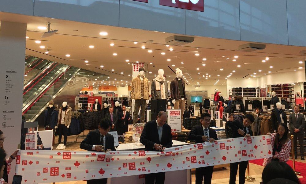 (Uniqlo Canada's CEO and COO cut the ribbon to the 25,500 square foot store)