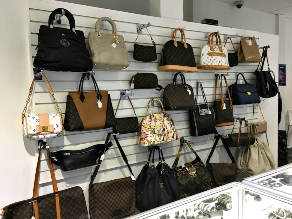 (The store boasts a considerable number of Louis Vuitton handbags)