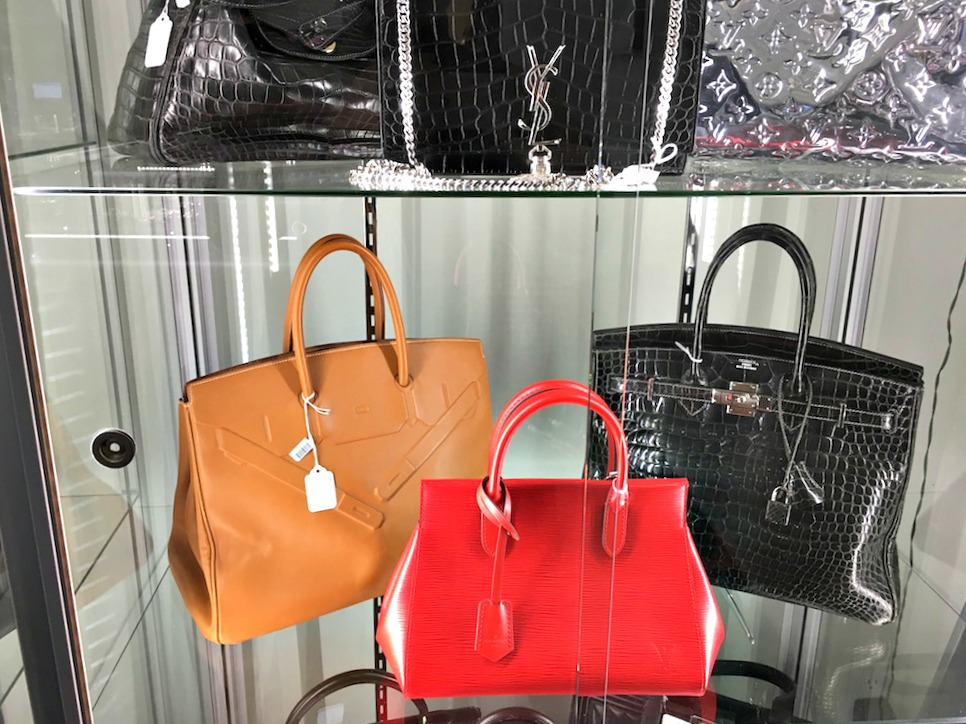 (Designer handbags, including Hermes bags priced over $10,000. The black Birkin, seen above and below, is priced at $90,000)