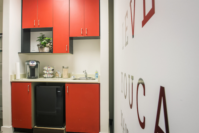 (rear kitchen area with coffee dispenser. photo:  BUILD IT By Design )