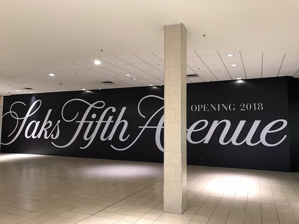 (Construction signage at the new cf chinook saks site in calgary)