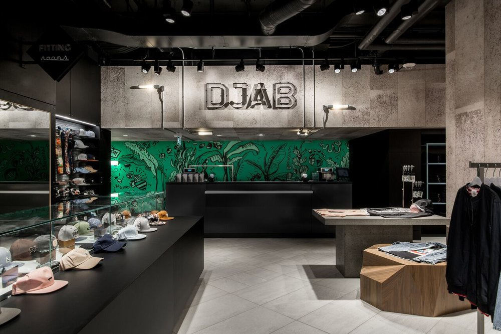 "(Djab , the young men's collections department, features a ""raw feel with concrete walls, industrial lighting and cityscape graphics."