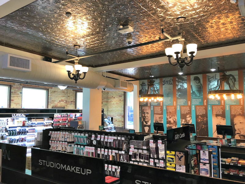 (tin ceilings were restored and included in the design of the new store)