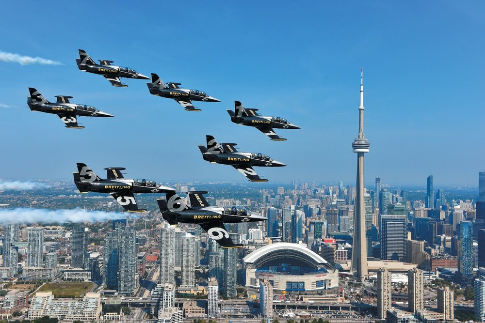 (Breitling jet team flying over toronto. photo Courtesy of Breitling SA, www.breitling.com)