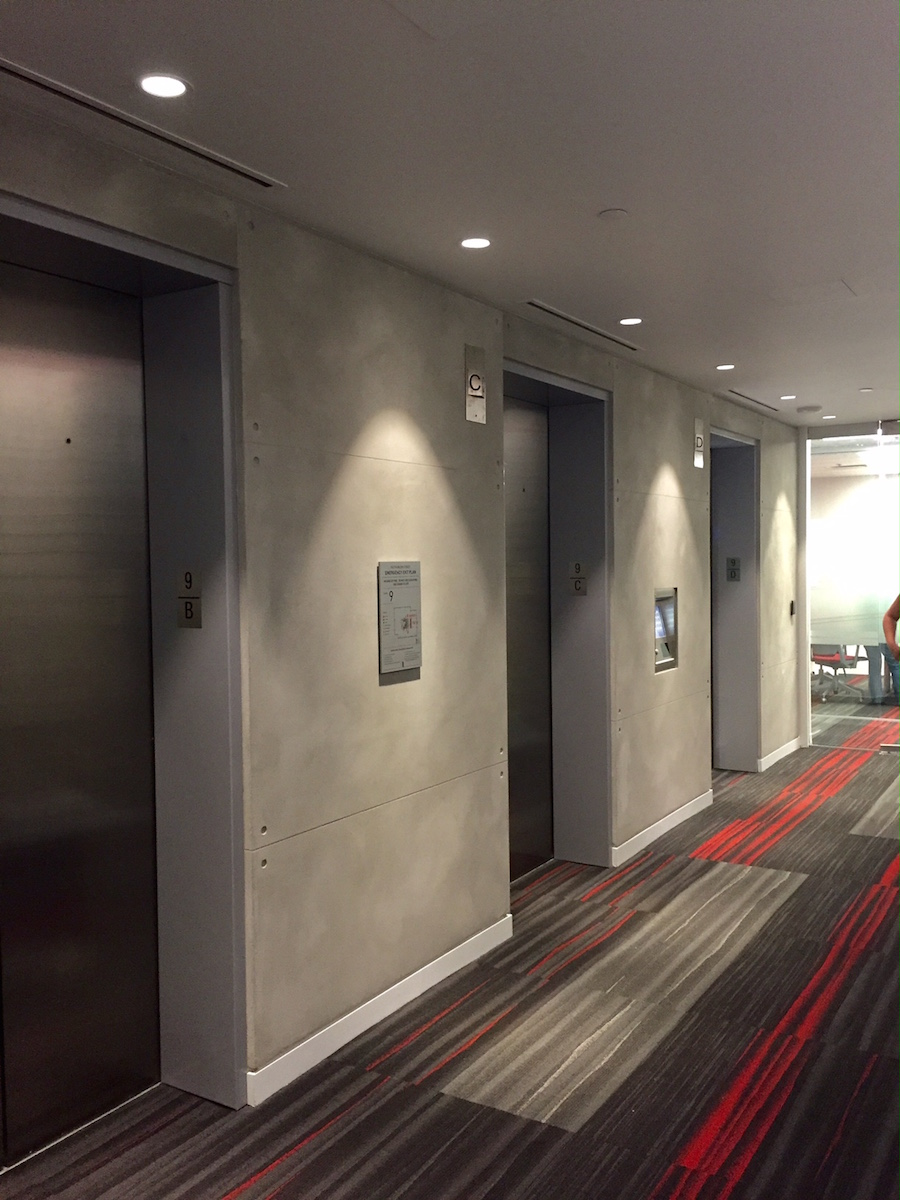 (elevator bank walls finished in plaster. Photo: Darrell Morrison)