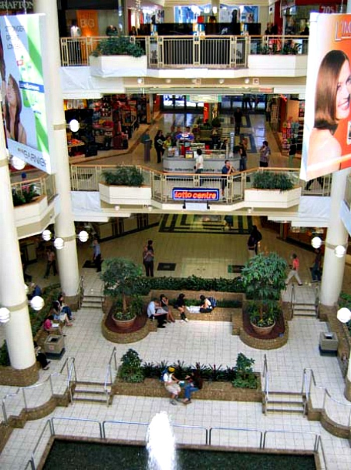 (former 'pacific centre north', looking down from the 3rd floor (now holt's women's designer floor) photo: city of vancouver)