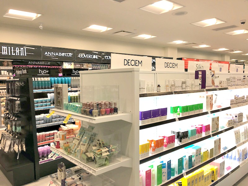 (the rexall drug store at yorkville village is the first in the chain to carry 'high-end' cosmetics)