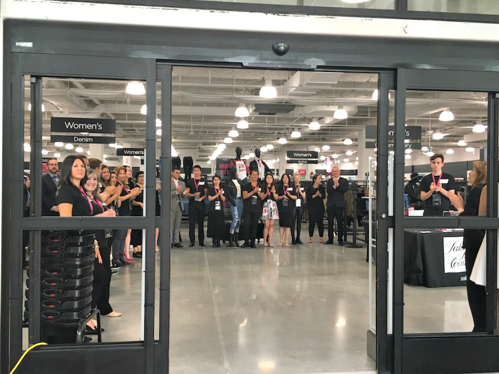 (staff gather to welcome shoppers to the park royal saks off 5th. Photo: Park Royal)