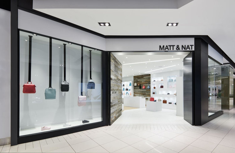 (an angled, inviting entrance attracts attention: Matt & Nat at Ottawa's CF RIDEAU CENTRE. PHOTO: PHOTOLUX STUDIO)