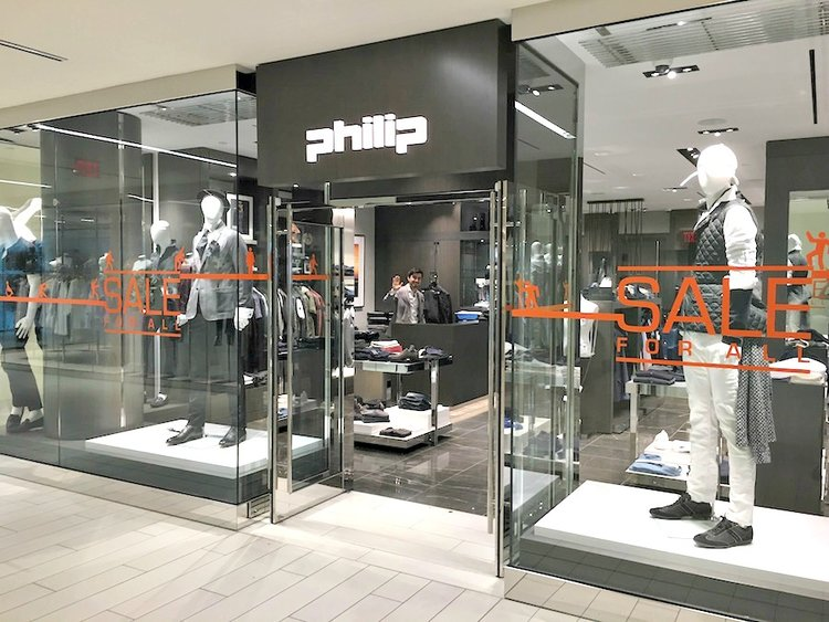 (a spacious entrance and creative displays at the 'Philip' store at Toronto's Yorkville village. Photo: Craig Patterson)