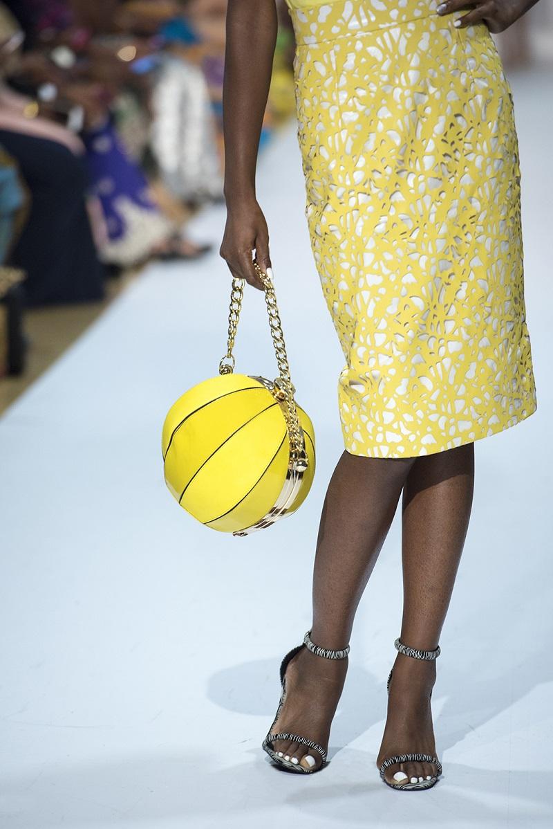 (yellow round purse and skirt -www.adebayojones.fashion)