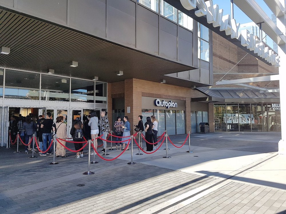 (Crowds line up outside for the opening of the new Metrotown Muji on the morning of Saturday, August 26. Notice to the right, MUJI has a glass exterior facade. Photo: MUJI)