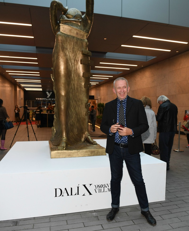 (Jean paul Gaultier stands outside an enormous sculpture at the opening of Yorkville Village's dali exhibit. This photo was taken in 'the laneway' that faces onto Yorkville avenue, and the exhibit can be viewed free of charge until the end of Septmeber)