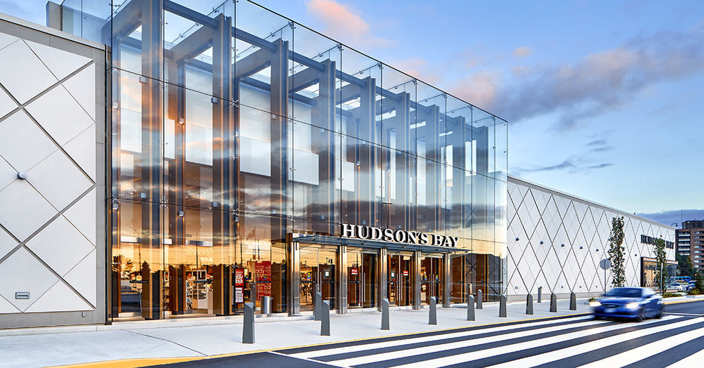 (Dramatic glass facade at the entrance to Hudson's bay -- natural light floods the space, making it feel welcoming)