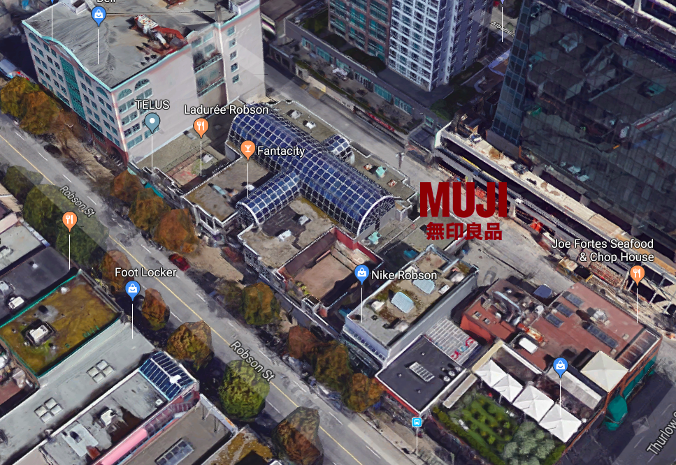 (Looking from above: MUJI's vancouver flagship includes the glass atrium formerly housing the 'Robson galleria' mini-mall that once occupied the site. The 10,000 square foot Polo Ralph Lauren store was eventually replaced by The Gap, prior to being leased to MUJI. Image: Google Street View)