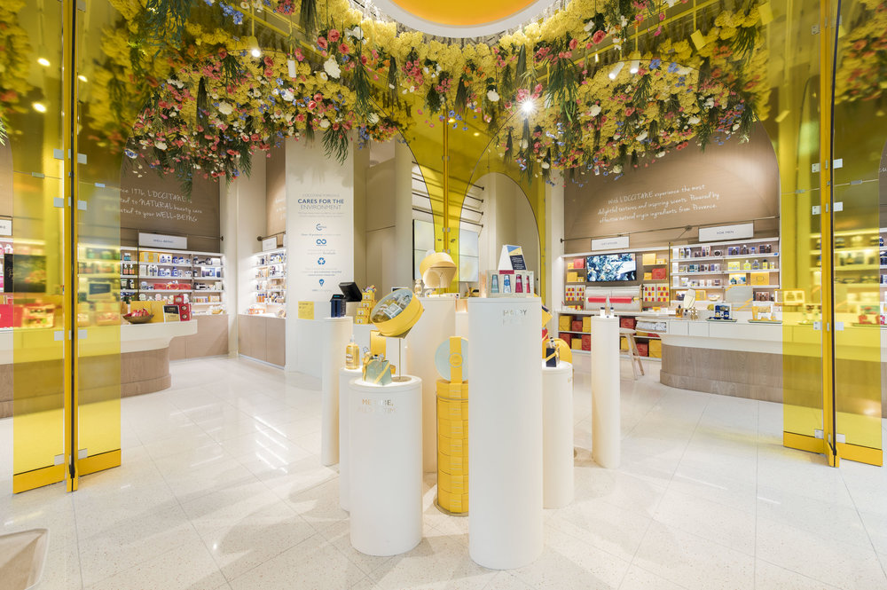 (The beautiful new space features flowers hanging from the ceilings, and yellow arches referencing the architecture of Provence in France)