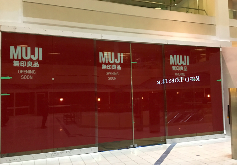 (Signage indicating where MUJI's Temporary pop-up space will be located inside of Atrium. Photo: Craig Patterson)