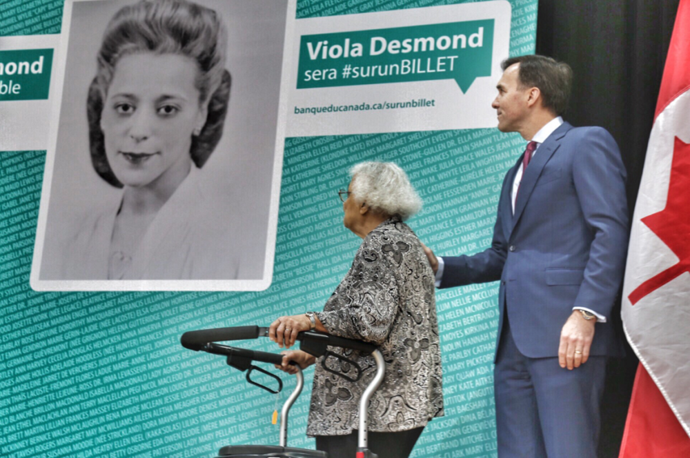 Announcement of new Note. Left is Viola Desmond's sister, Wanda Robson, with Finance Minister Bill Morneau on the right. Photo:  Bill Morneau Twitter .