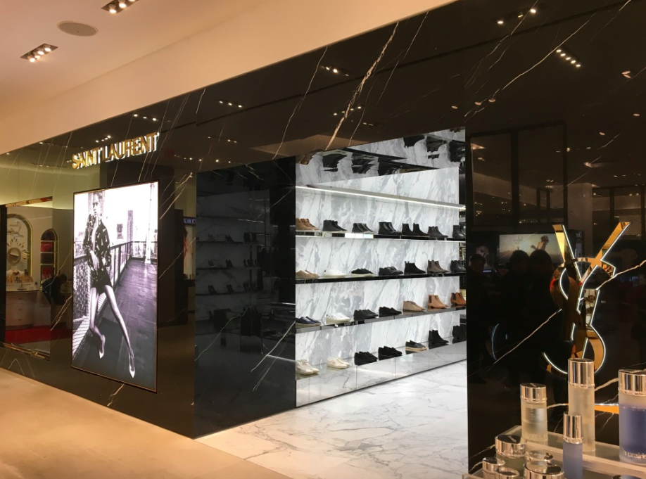 [This photo was taken from within Holt Renfrew's ground floor cosmetics hall, showing the entrance to the new Saint Laurent. Men's shoes can be seen in the photo]