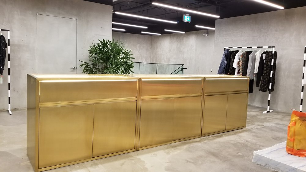 [Impressive gold cash desk on the store's second floor. PHoto: Helen Siwak]