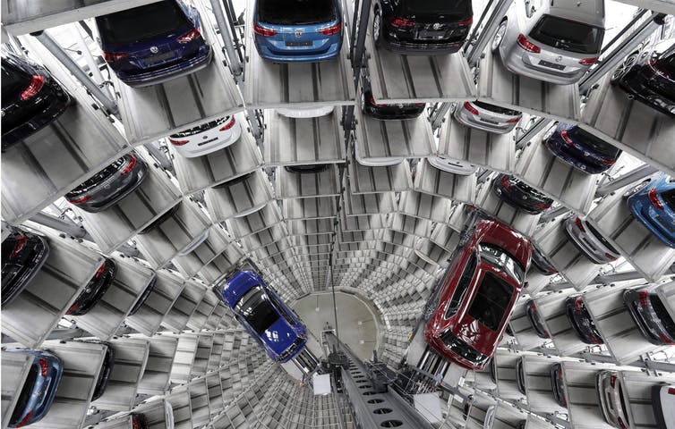 Volkswagen cars are lifted inside a delivery tower of the company in Wolfsburg, Germany in March 2017. The CEO of Volkswagen said the United States remains a core market for the company despite its diesel emissions scandal. (AP Photo/Michael Sohn)