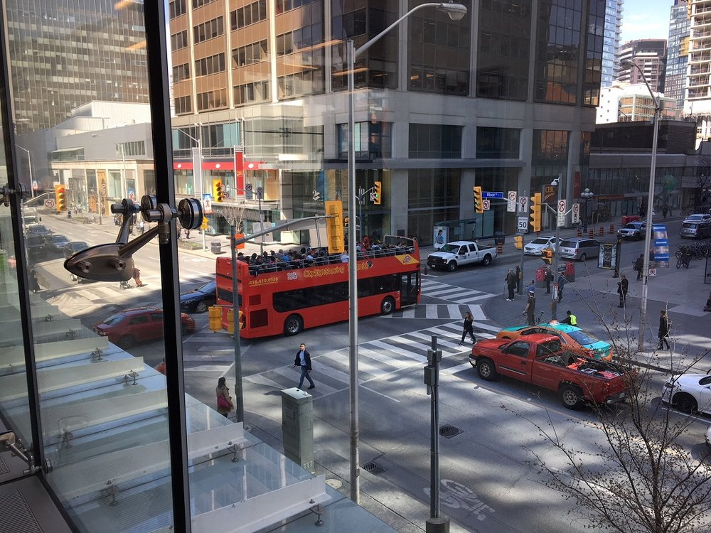 Looking from within the store on the second floor down to the intersection of Yonge & Bloor