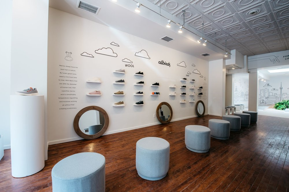 Wall showcasing shoes made from 'wool' and 'tree', with ample seating. Photo: allbirds