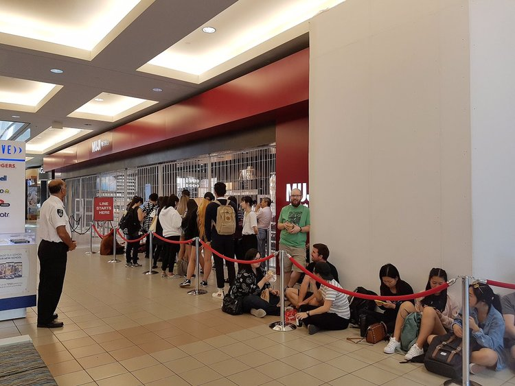 CROWDS LINE UP FOR THE OPENING OF THE NEW METROTOWN MUJI ON THE MORNING OF SATURDAY, AUGUST 26. PHOTO: MUJI