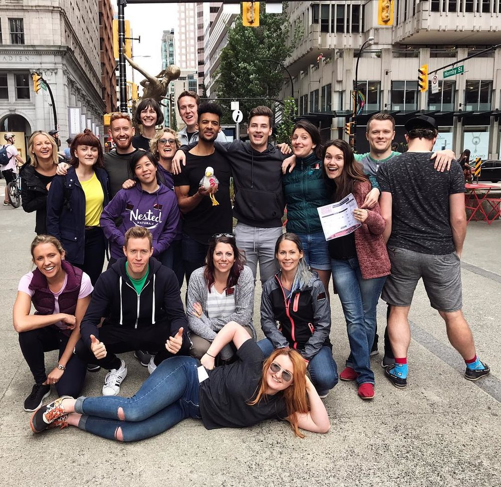 The team from Nested Naturals pose for a photo at the corner of West Hastings Street and Hornby Street in Downtown Vancouver