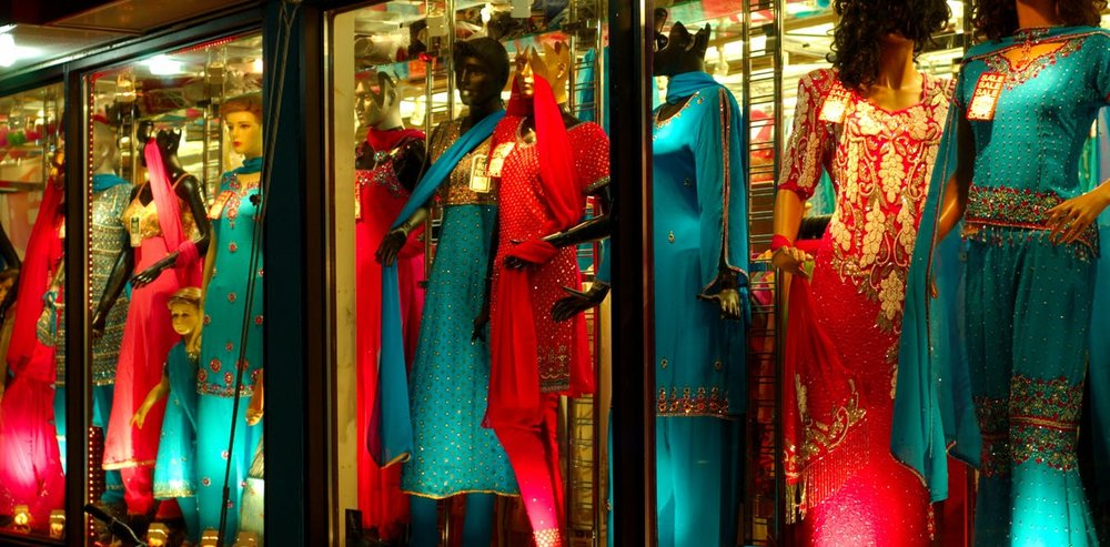 Small business owners provide a service by offering goods not found elsewhere and employing local community members. Here, a sari shop window in Toronto's 'India Bazaar.' Ian Muttoo , CC BY-NC