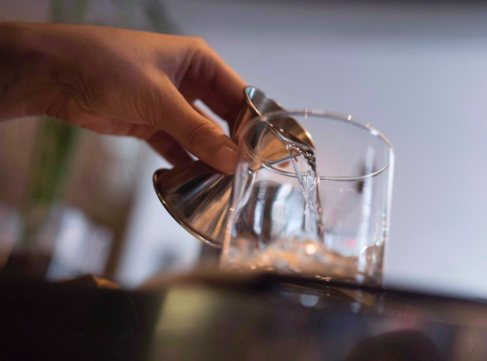 An Ottawa bartender makes a cocktail in this 2015 photo. Booze isn't taxed as highly as tobacco in Canada. THE CANADIAN PRESS/Justin Tang