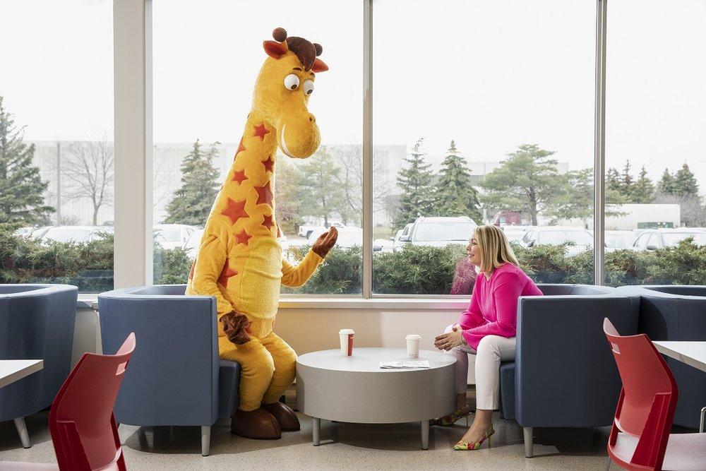 "Melanie Teed-Murch, president of Toys""R""Us Canada, in conversation with Geoffrey theGiraffe. Below: Geoffrey theGiraffe and a store employee. Photos supplied."